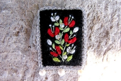 24_island_red_brooch_